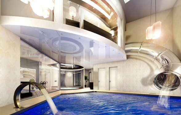 having a water slide by your pool is always tons of fun but what about having one that comes straight from your bedroom the modern home above adds some