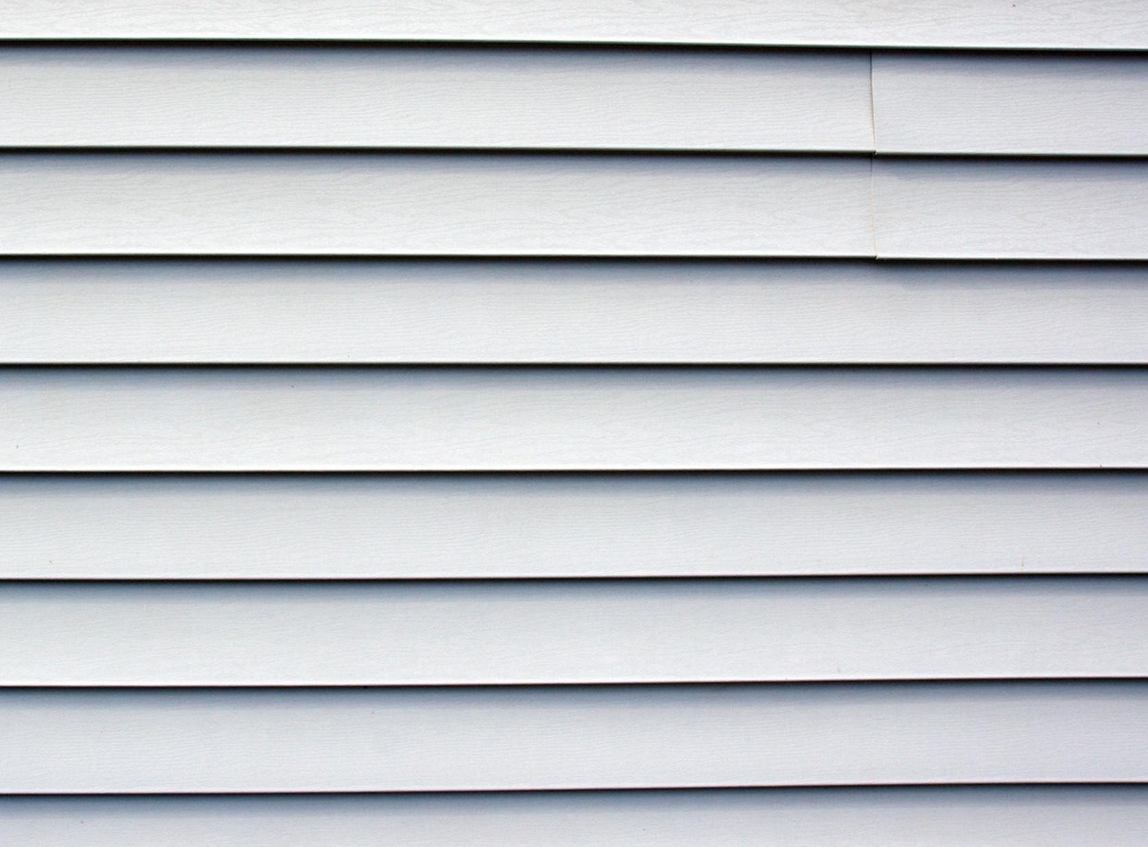 Comparing james hardie fiber cement siding to other siding for Types of house siding materials
