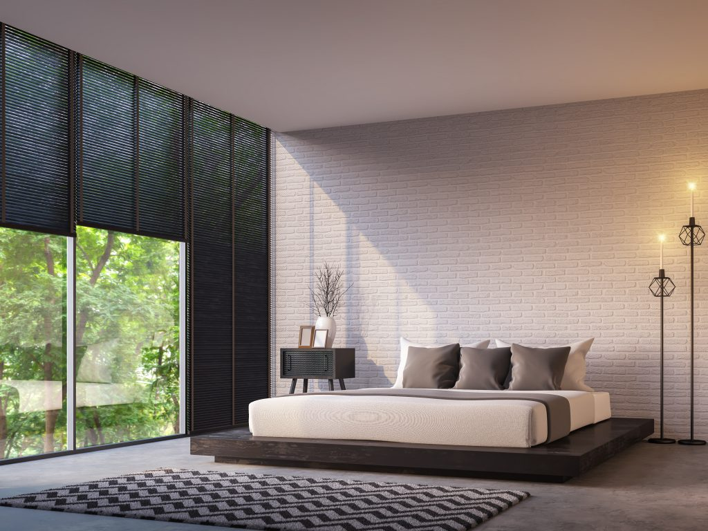 Modern loft bedroom with nature view 3d rendering image Furnished with Black wood furniture has concrete floor,white brick walls and large windows look out to nature.